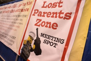 A sign displays information for how to retrieve lost kids at LEGO KidsFest in Novi, Mich. on April, 27 2014.  (credit: George Fox/CW50)