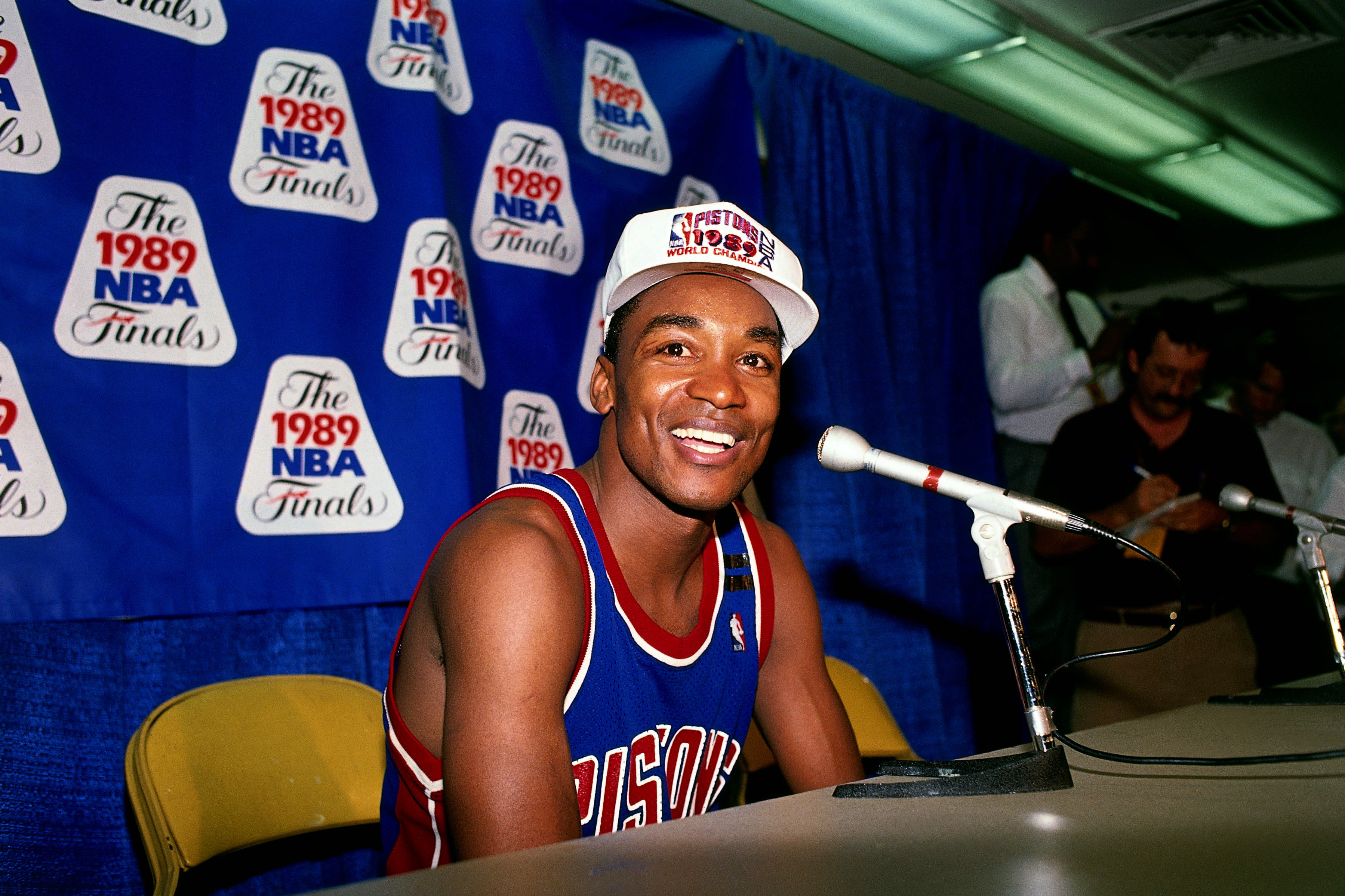 INGLEWOOD, CA - JUNE 13: Isiah Thomas #11 of the Detroit Pistons smiles for the camera during the Postgame Press Conference of game four of the NBA Finals. The Detroit Pistons defeated the Los Angeles Lakers to win the championship at The Great Western Forum on June 13, 1989 in Inglewood, Calfifornia. NOTE TO USER: User expressly acknowledges that, by downloading and or using this photograph, User is consenting to the terms and conditions of the Getty Images License agreement. Mandatory Copyright Notice: Copyright 1989 NBAE (Photo by Nathaniel S. Butler/NBAE via Getty Images)